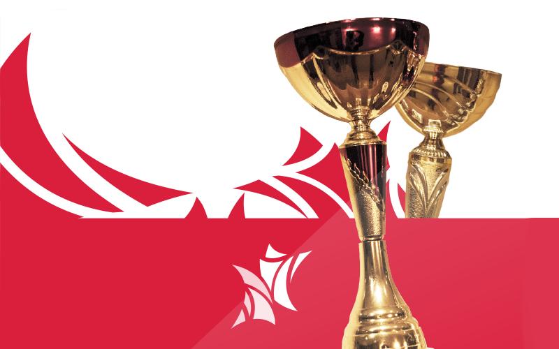 grafika przedstawia złoty puchar i logo klubu tańca towarzystkiego nowy styl